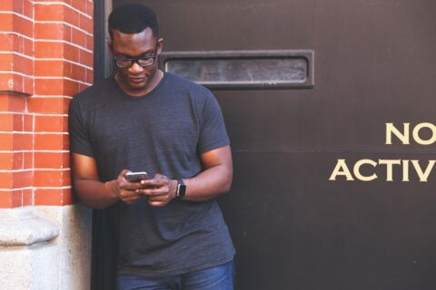 Black man searching content on mobile